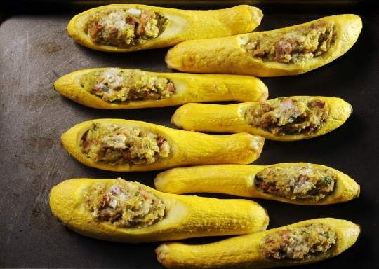 Stuffed Yellow Squash offers a delicious and different recipe for this warm-weather garden staple.