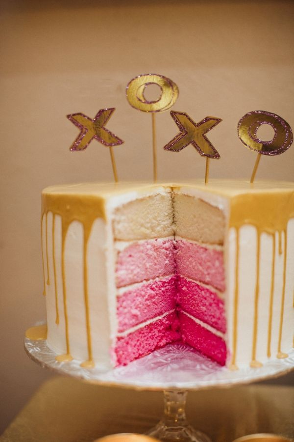 pink ombre cake with gold icing, photo by Sara & Rocky Photography http://ruffledblog.com/gold-and-pink-valentines-day-shoot #weddingcake #cakes #pinkandgold