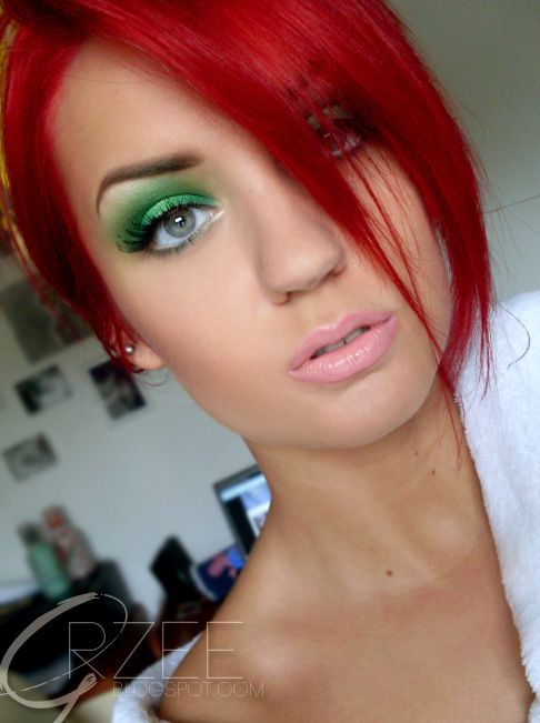 Green eyeshadow and red hair.