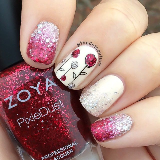 Valentine's nail art using @zoyanailpolish Pixie Dusts Oswin and Lux. Nude base is @opi_products My Vampire is Buff  stamped with @konad_art Special Polish in Black, and @moyou_london Princess plate 14. Flowers were painted in with Oswin and Lux.