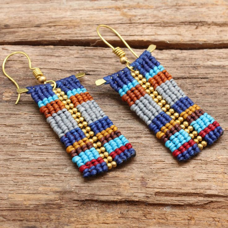 Funky woven tribal pattern cotton earrings with brass beads and frame by cafeandshiraz on Etsy https://www.etsy.com/listing/162343945/funky-woven-tribal-pattern-cotton
