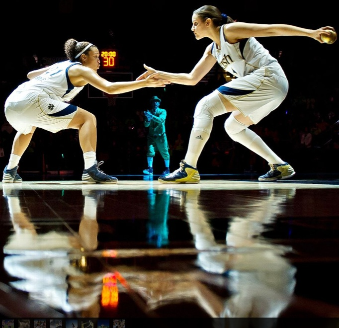 That 6th sense moment with your teammate during a signature handshake. Notre Dame guard Kayla McBride, left, and Natalie Achonwa greet each other during warm ups.