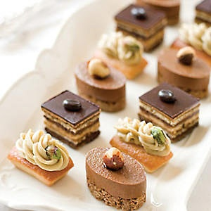 """Mini Patisserie. almond cake, chocolate ganache and coffee buttercream, while chocolate mousse, hazelnuts, and chocolate cake make the """"Royales"""" a standout. And """"Amarenas"""", with pistachio Bavarian cream are absolutely divine."""