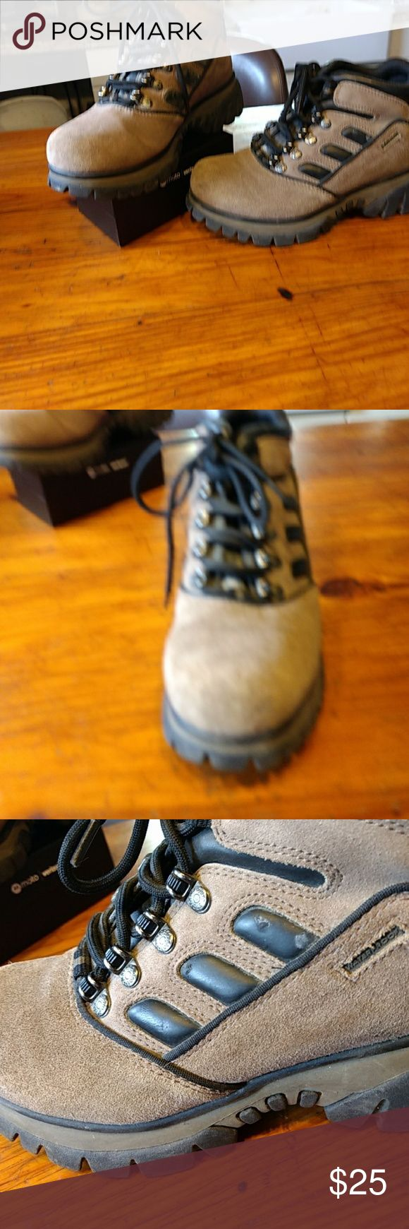 Sporto Hiking Boot Black leather trim, light brown suede.  The bottoms are great for many outdoor sports.  Black& silver metal logo on back of boots.  They are lace up secured by tiny silver rivets.  The leather on inside of both tongues are worn.  The sides & back are covered with material that makes feet breathable.  Because of damage to inside part where you lace up, I have to let go low.  And believe me, they were worth the price I paid. Sporto Shoes Combat & Moto Boots