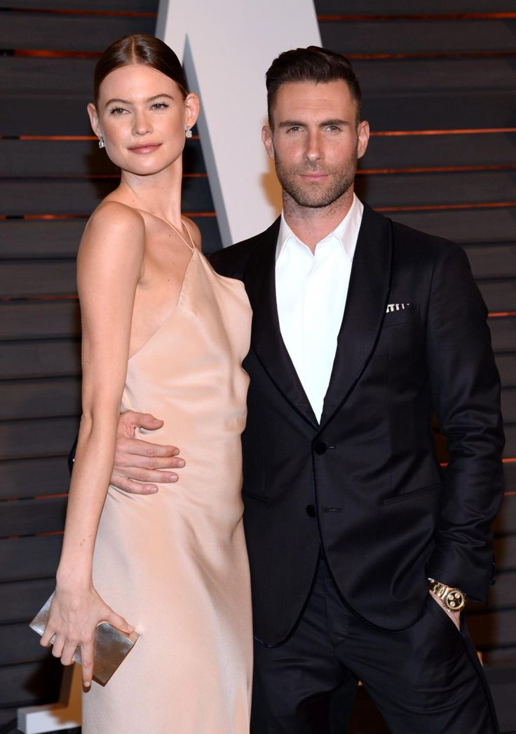 ADAM LEVINE, BEHATI PRINSLOO  After a year of dating Victoria's Secret model Behati Prinsloo in 2013, Adam Levine ended up breaking things off with her. Immediately following their break up, Levine started hooking up with fellow model Nina Agdal and even spent a Mexican vacation together. However, once they returned, Levine reportedly broke it off with Agdal via text message and soon after became engaged to Prinsloo.