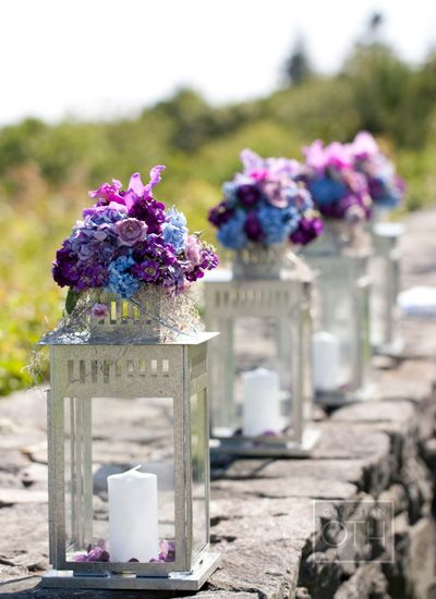 Could use something like this in the aisle in the church and then bring them to the reception as centerpieces