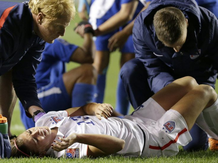 Alex Morgan after injuring her ankle against Guatemala on Oct. 17, 2014. (Nam Y. Huh/AP)