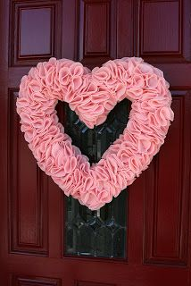 I invited a few friends over so we could make these adorable ruffled heart wreath I found here .   It said each heart uses about 3/4 of a y...