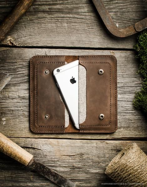 This simple wallet was designed to hold two phones, your cash or cards in one compact and safe haven. Two compartments are wool linedso phone is well protected