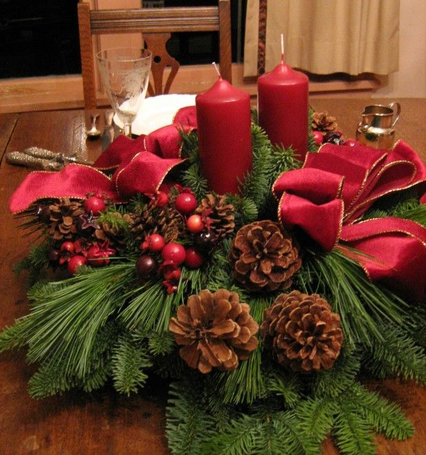 Remarkable Red Tapes And Green Leafs Two Candles At Natural Rustic Wooden Dining Tables For Christmas Table Arrangements Inspiring Ideas