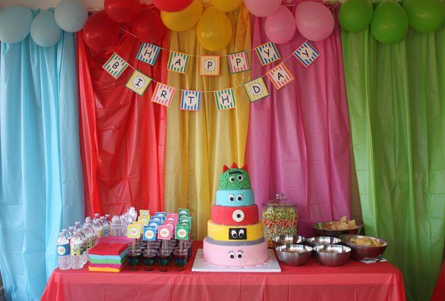 Yo Gabba Gabba Birthday Party. Use multi-color plastic tablecloths and balloons as a backdrop! :)