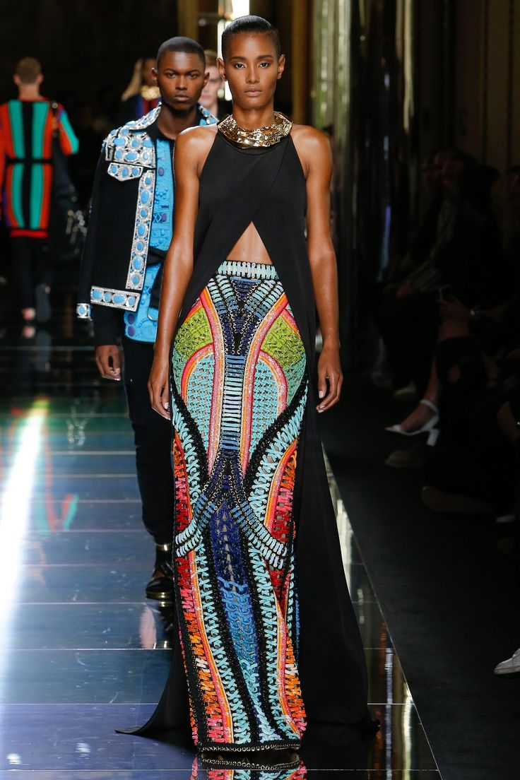 This. Goddess skirt. Structured and strong. Like shoe laces and chains. Colours are a 70s music video - Balmain Spring 2017