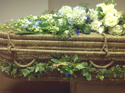 Seagrass coffin with natural garden flowers. Posies, spray and garland. www.naturalendings.co.uk