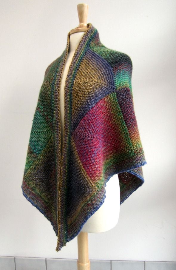 pattern here http://www.ravelry.com/patterns/library/mochi-plus-mitered-shawl