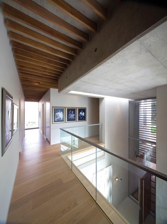 Mezzanine Landing Design With Glass Balustrade