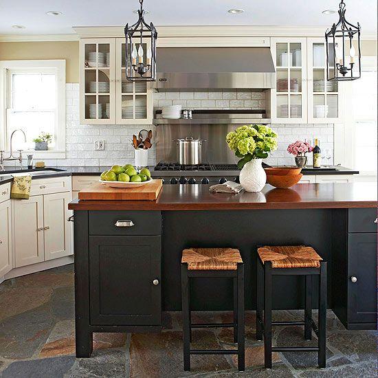 A contemporary black island looks sleek in this farmhouse kitchen. Tour the rest of this traditional kitchen: http://www.bhg.com/kitchen/remodeling/makeover/traditional-farmhouse-kitchen-makeover1/?socsrc=bhgpin111312farmhousekitchen