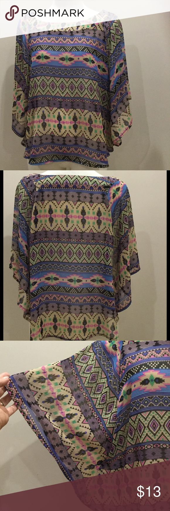 🌷 Charlotte Russe Aztec Print batwing top Charlotte Russe sheer Aztec Print batwing top. Light and flowey Size XL. This item is a REPOSH. code T3 Charlotte Russe Tops Blouses