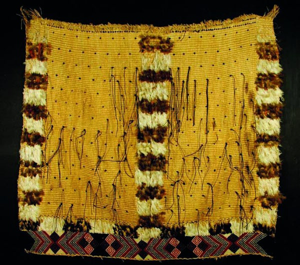 19th century Maori feather and flax cloak with a large taniko