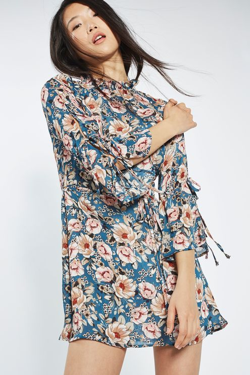 We love the feminine feel of this tea dress in pretty peony print. In a mini cut, it comes with a high neckline and long sleeves that feature cute tie detail. Toughen up the look with a leather jacket and ankle boots.  #Topshop
