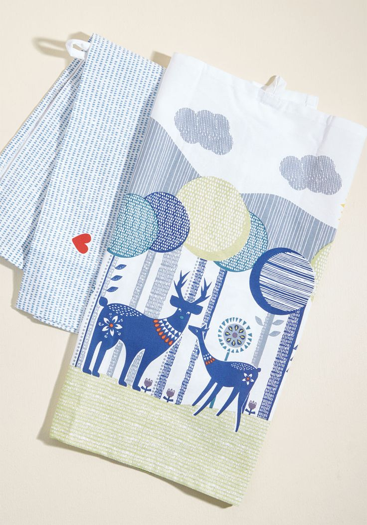 <p>Like something from a fairytale, the storybook scene of forest creatures on these tea towels have captured you with their magic! This white pair depicts a petite heart on one towel and a geometric-style landscape of trees, foxes, and owls on the other, which look adorable when hung in your kitchen with their little loops.</p>