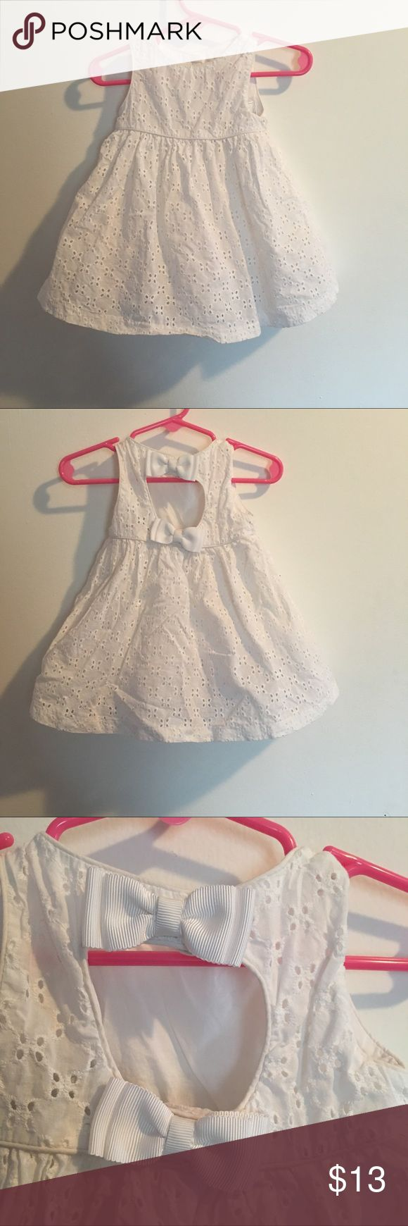 {Gymboree} White Summer Dress Adorable white summer dress with tuelle underneath. Keyhole in the back with two bows. Used once for a wedding. Tag says 6-12 months but fits 9 months best. Gymboree Dresses Formal