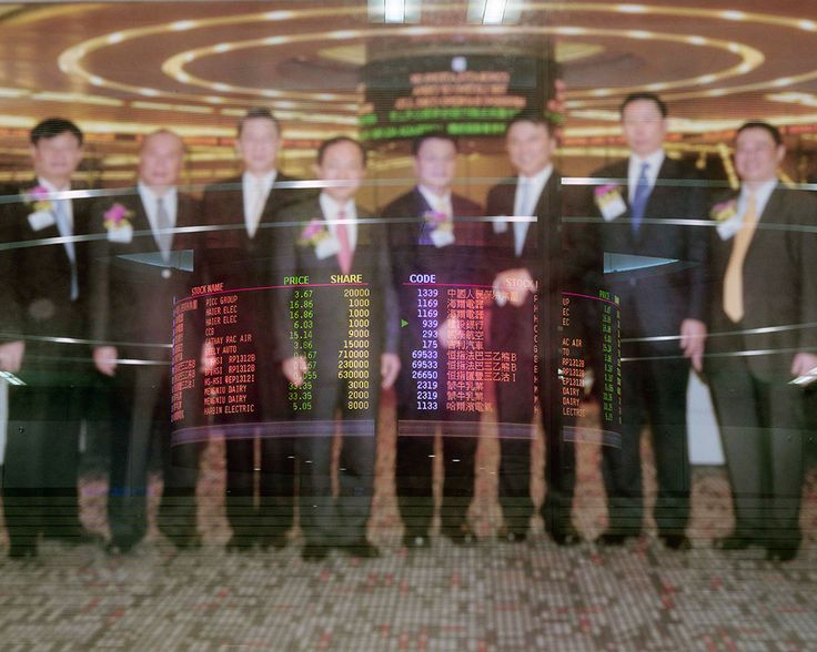 At the Hong Kong Stock Exchange, real-time stock quotations are reflected in a photograph celebrating the successful 2009 listing of a Chinese bank, which raised 31 billion HK dollars. Hong Kong's Stock Exchange is the sixth-largest in the world and the second in Asia in terms of value of shares traded. Hong Kong