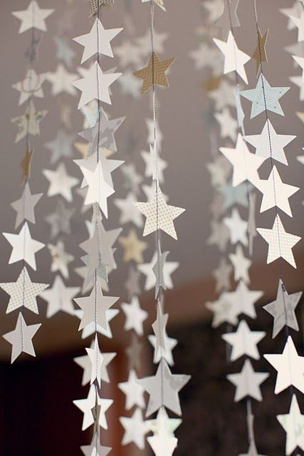 Stitched garland of stars. Night Under the Stars or Oscar/Academy Awards party idea (but I would do gold and/or silver stars.)