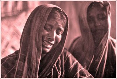 Women grieving the loss of their husbands in the cyclone on Urir Char Island, Bay of Bengal, Bangladesh -- May, 1985