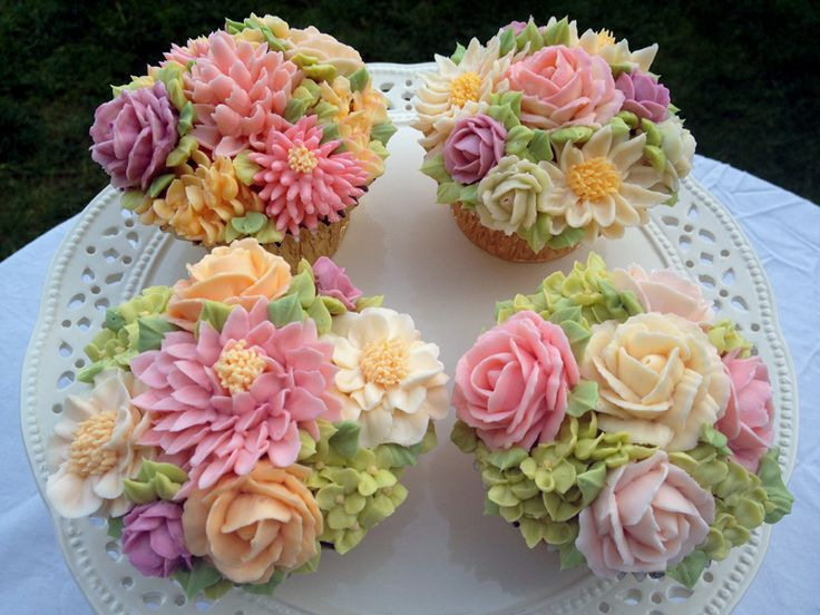 Pastel floral bouquet decorated cup cakes