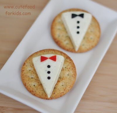 Tuxedo Appetizers.  Laughing Cow Cheese Wedges on Crackers topped with Black Olives (Black Tie) or Red Pepper (Red Bow Tie).  Could also use carrot, ham, cheddar, green pepper, etc.