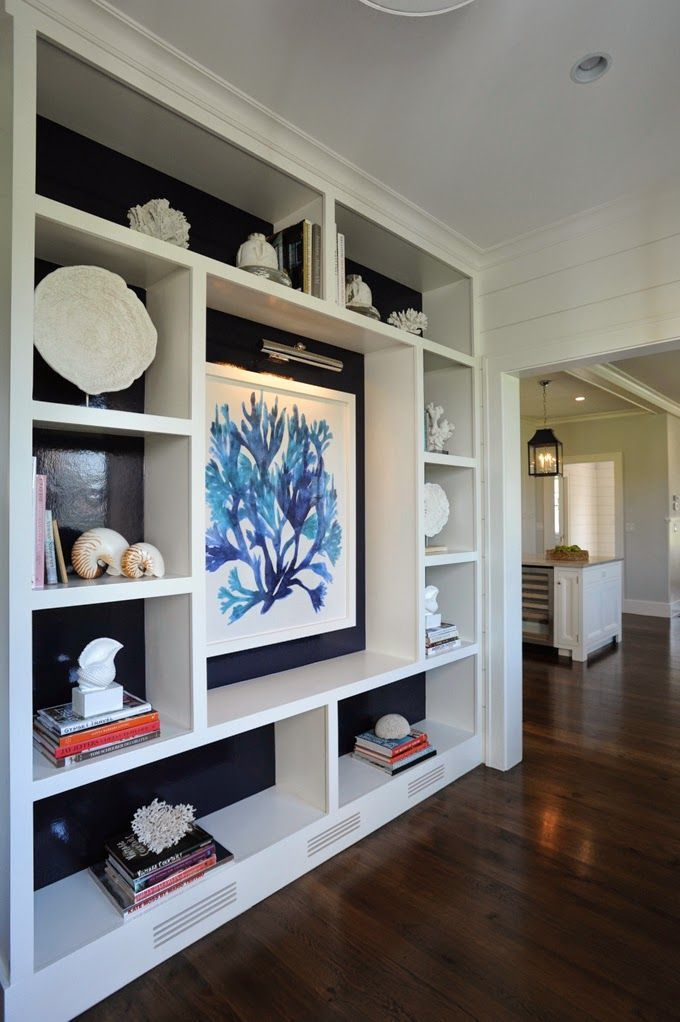 I K I - Black backing to this bookcase gives the contents a moment to shine!  A really good example of styling