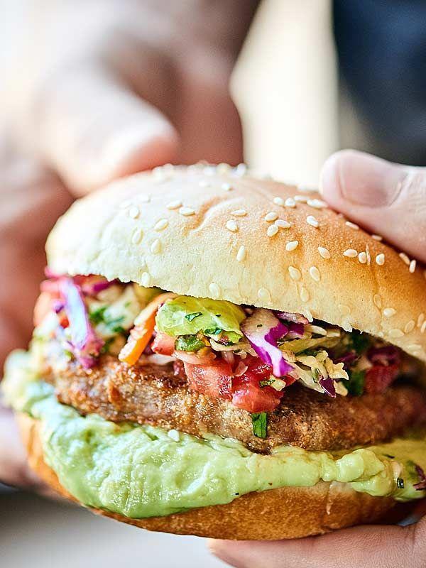 These are the BEST Mexican Turkey Burgers. Tender turkey burgers, crunchy slaw, fresh pico, & an avocado sauce make these great for an easy, healthy dinner! http://showmetheyummy.com #ad #jennieo /jennieorecipes/