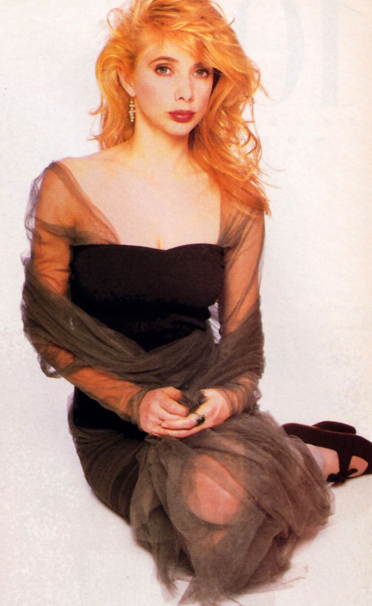 Rosanna Arquette photographed by Jacques Malignon for Harper's Bazaar, September 1988. Dress by Romeo Gigli.