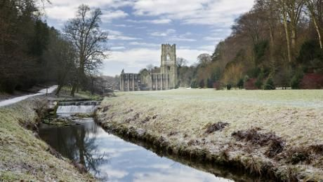 Fountains Abbey in winter - abbey by the river Skell