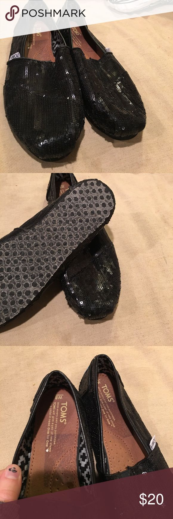 BLACK GLITTER TOMS👣 I'm selling this pair of black glitter toms! They are fairly new and as you can see in the fourth picture they do have some missing on the toe, not very noticeable though! They are a size 8! Happy poshing 🖤 TOMS Shoes Flats & Loafers
