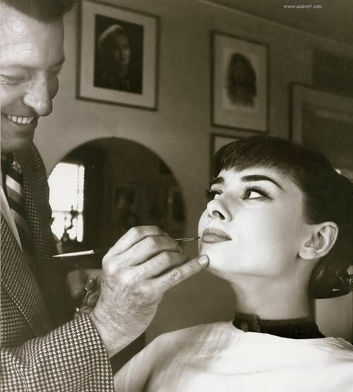 Audrey Hepburn in the makeup chair.