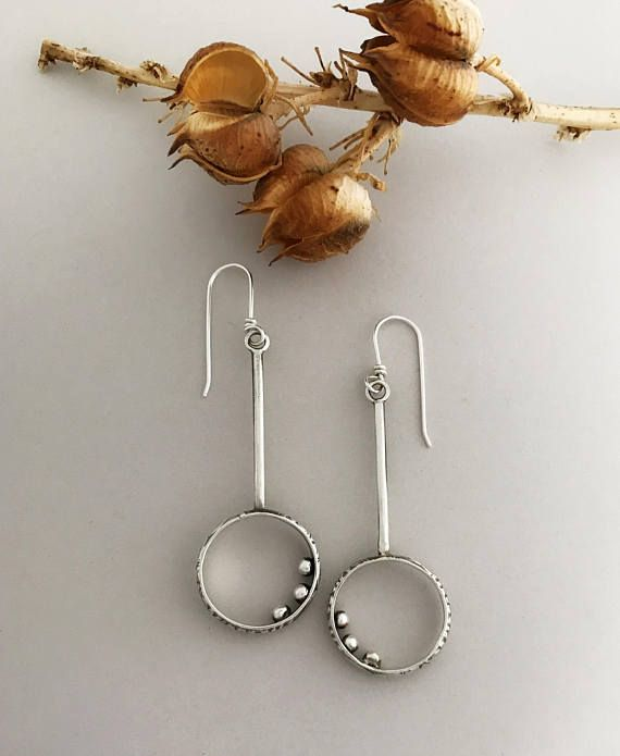 Handcrafted sterling silver earrings with hoops and sterling balls inside. Each ear wire is handmade with 20 gauge sterling. Please check out the thumbnail photos and a description below.  All my ear wires are sterling silver and handmade by me.  The length of these earrings from the