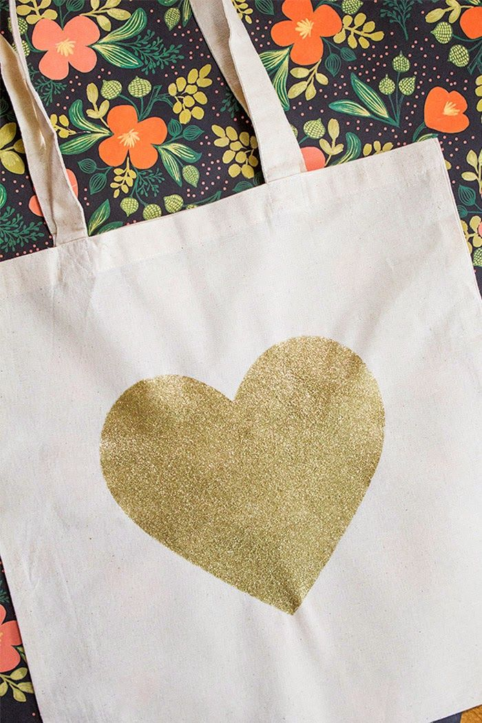 Poppytalk gold glitter painting on tote bag.  Also inspiring print behind.