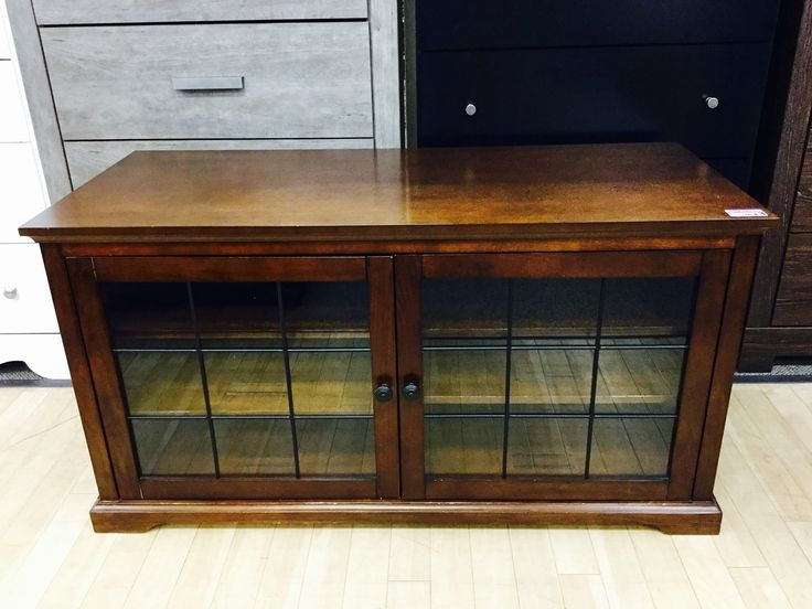 Gorgeous three tier solid wood tv stand with glass doors in great condition and priced nice at only $125. Open until 6pm on weekends!