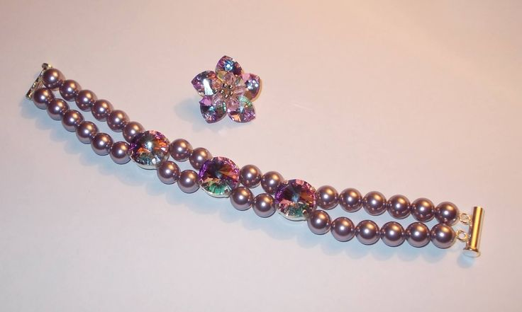 Swarovski pearls and crystals bracelet and brooch You can place an order at delizejewelry@yahoo.com