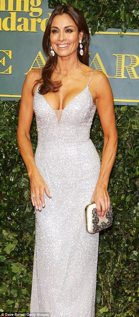 Flying solo: 'Single' Melanie Sykes, 47, showed off her eye-popping cleavage in a dazzling...