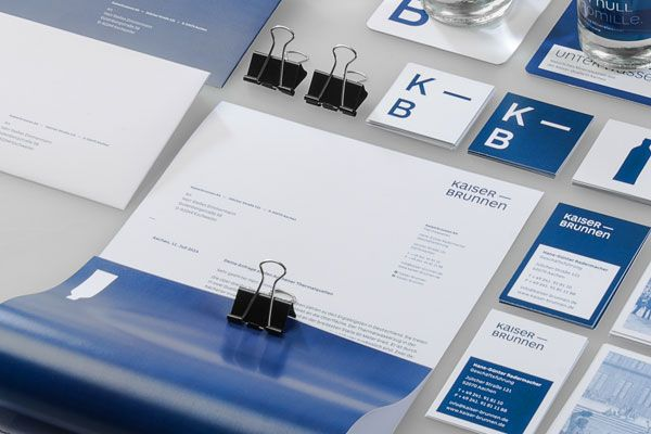 Close up of the stationery set and diverse printed matters.
