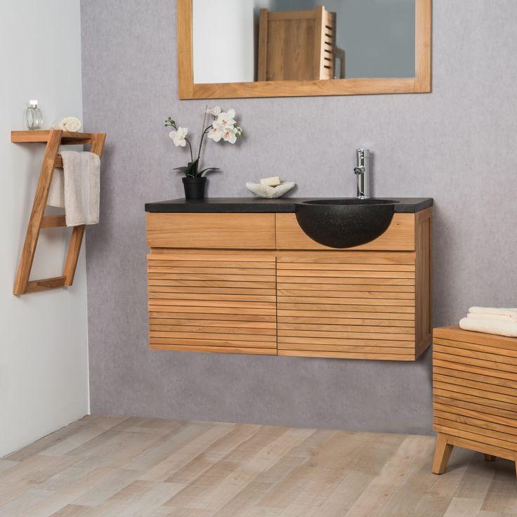 Ce meuble de salle de bain en teck suspendu s'intégrera parfaitement dans votre salle de bain. Le mélange de teck massif et de terrazzo lui confère un style très contemporain. Ce meuble sous vasque est équipé d'un tiroir et deux portes pour un bel espace de rangement. Vendu hors robinetterie Dimensions meuble Longueur : 100 cm Hauteur : 52 cm Profondeur : 40 cm Dimensions vasque Diamètre : 40 cm Longueur : 100 cm Hauteur : 12 cm Profondeur : 50 cm