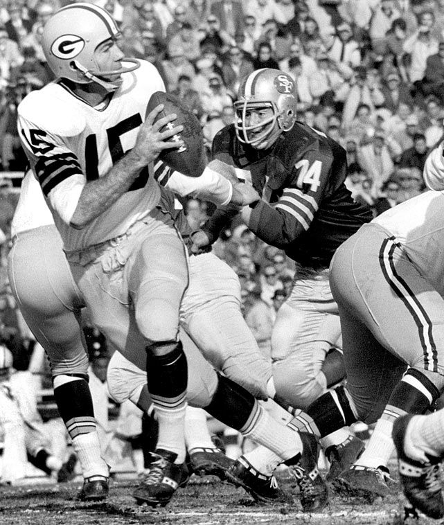 Bart Starr, pictured here in a 1963 game against the San Francisco 49ers, is the only player to quarterback his team to five NFL Championships.