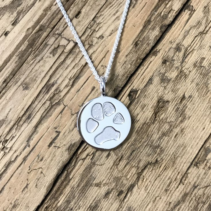 Pet Paw Print Charm in sterling silver. Create jewelry with pics of your pet's paw.