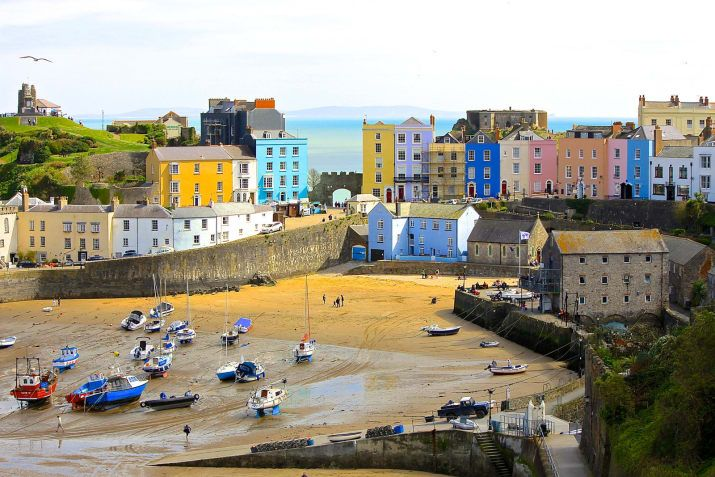 Of all the seaside towns in Wales, none are as charming as this pastel-clad village on Carmarthen Bay.