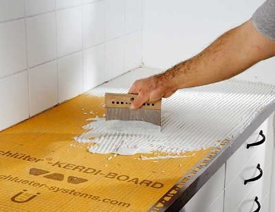 Tiled kitchen counter tops. cheaper alternative than getting granite or marble countertops slabs