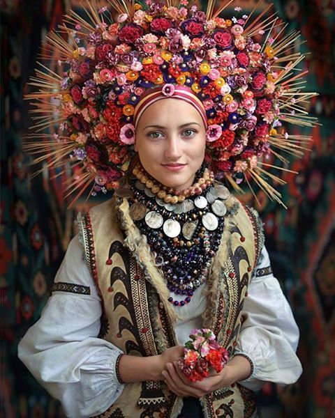 In Ukraine, That Flower Crown Means More Than You Think! While you may have thought that the flower crown was simply a Coachella staple, or a sweet finishing touch for a bride, in Ukraine it means so much more. Across Instagram, the bridal flower crown is gaining resurgence, yet this time as a behemoth botanical orb. This isn't just a supersized trend; these woven headpieces are the Ukranian Vinok. The Ukrainian wreath is a type of wreath which, in traditional Ukrainian culture, is worn by…