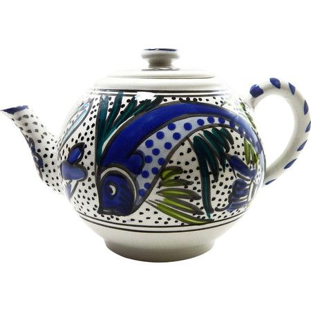 Featuring a folk art-inspired pattern, this lovely teapot brings Mediterranean appeal to your tablescape.Product: Teapot...