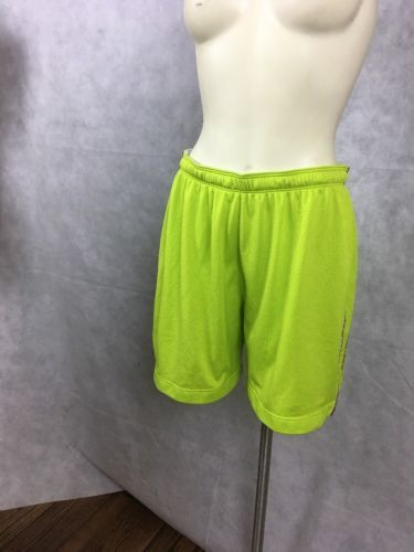 Under Armour HeatGear Women's Neon Lime Green SHORTS Size M. 292